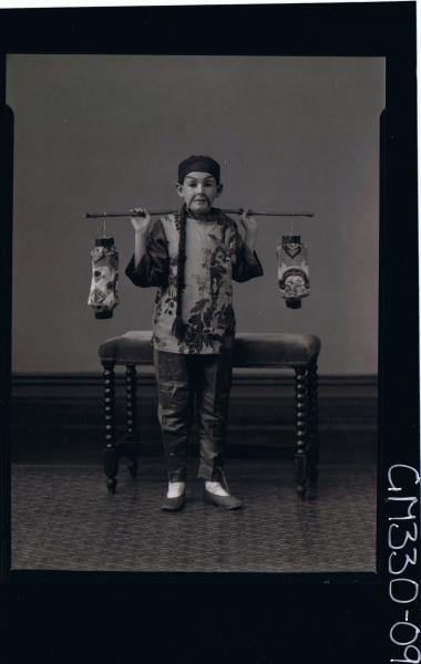 F/L Portrait of boy standing, wearing chinese fancy dress costume; 'Mills'