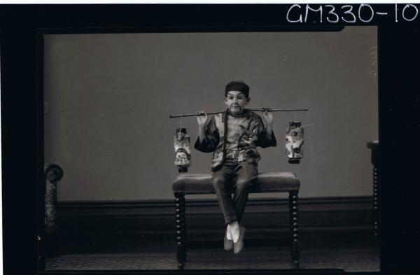 F/L Portrait of boy seated, wearing chinese fancy dress costume; 'Mills'