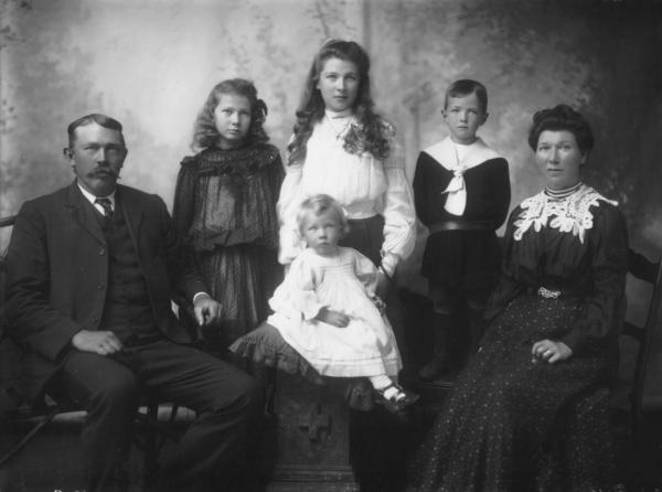Mr J Rafface, family portrait, seated parents, note woman's lace collar, two girls and younger boy standing, seated child.