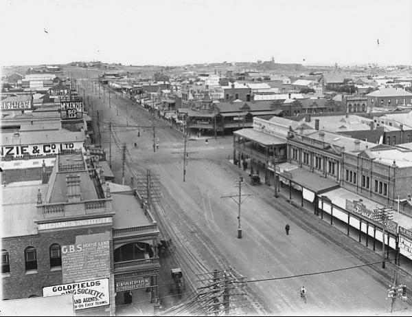 Hannan Street, looking up to Mt Charlotte, Bricknell Store, Mechanics Institute, and other buildings visible-McKenzie & Co, Kalgoorlie miner,Alexander.  1919
