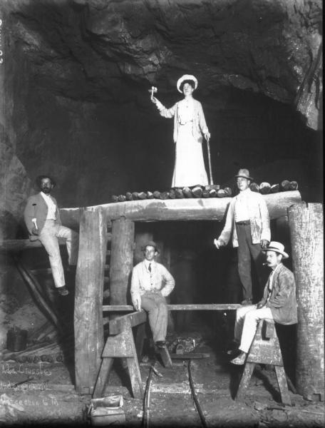 Ada Crossley underground at Golden Horseshoe, standing on Platform, four men arranged below Ada, Jack Sutherland lower right.