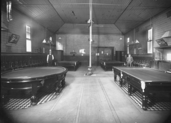Interior of games room at Mechanics Institute showing Billiard tables, one table is oval shaped.