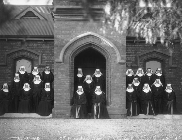 Group of Nuns in front of St. John of Gods Hospital, Miss Stephens.