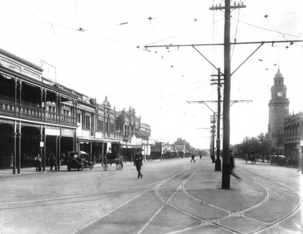Hannan Street taken from Maritana Street Corner showing Mackay Photographic Studio, Post Office Clock Tower and other Buildings.