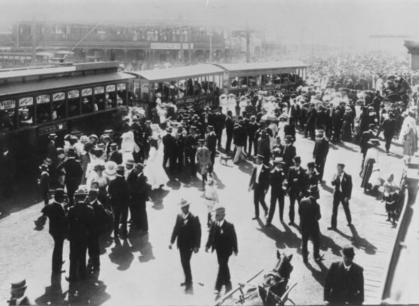 Large Street Crowd getting on Trams - Racecourse Specials, Hannan Street and Maritana Street Junction.  Australia Hotel in background.