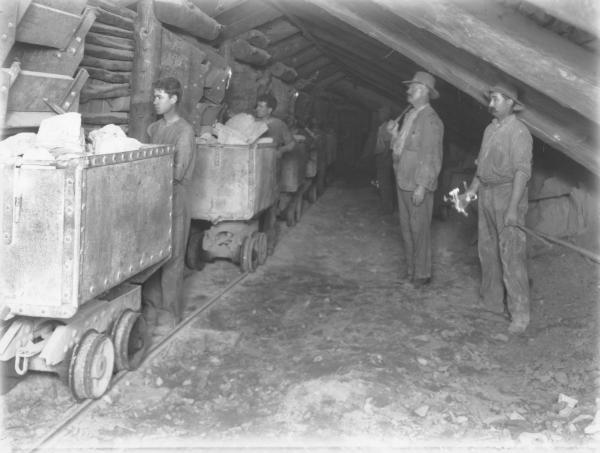 Underground workings and men at Perserverance gold mine.