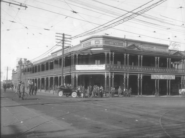 Looking along Boulder Road from Hannan Street Corner, Palace Hotel, Dwyers studio, Palace pharmacy visible.   1913