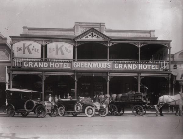 Motor Cars and Brewery Cart in front of Grand Hotel, Hannan Street - Facade visible. 1925