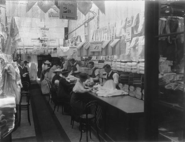 Interior of Brennan Brothers store with customers and assistants.