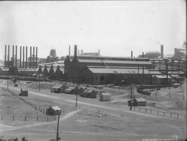 View of Perseverance Gold Mine showing Headframe, Chimneys and Associated Mine Buildings.