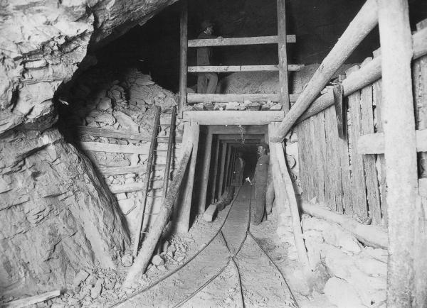 Oroya Brown Hill Mine Underground showing timbering and men.