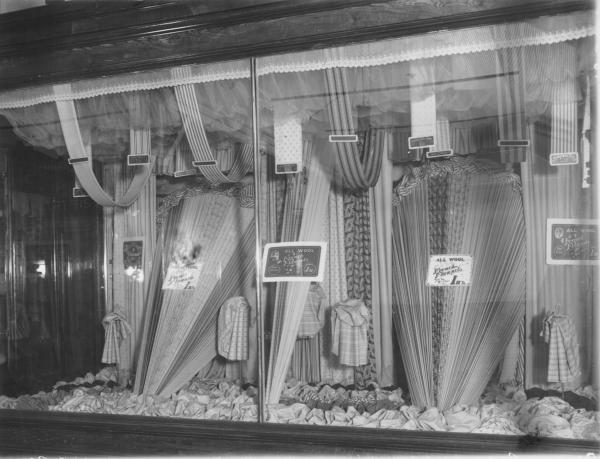 Brennan Bros shop window displaying assorted materials.