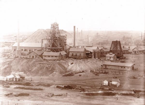 Great Boulder Mine showing two large store tanks, large corrugated shed in background.