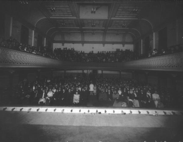 Interior of Boulder Town Hall. Miss Grimley's Benefit Concert taken from stage overlooking audience and balcony. Front of stage visible.