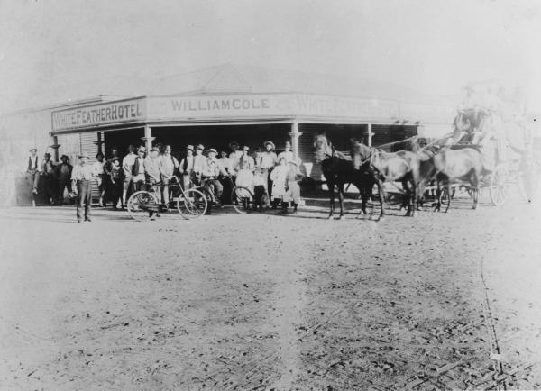 White Feather Hotel, Kanowna, licensee William Cole.  Group of men and children standing outside hotel two with bycycle's.  Stagecoach with four horses and several people aboard