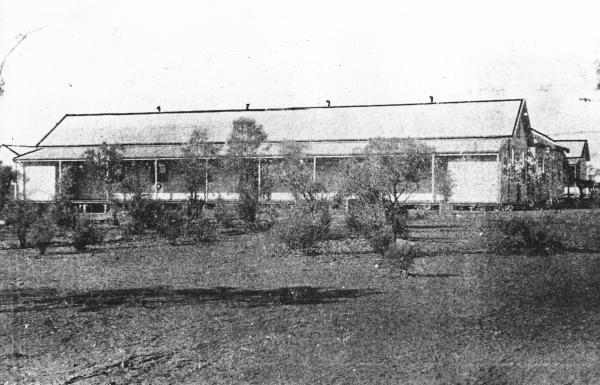 Kanowna Hospital 1902,shows hospital buildings with sparce vegitation in front.