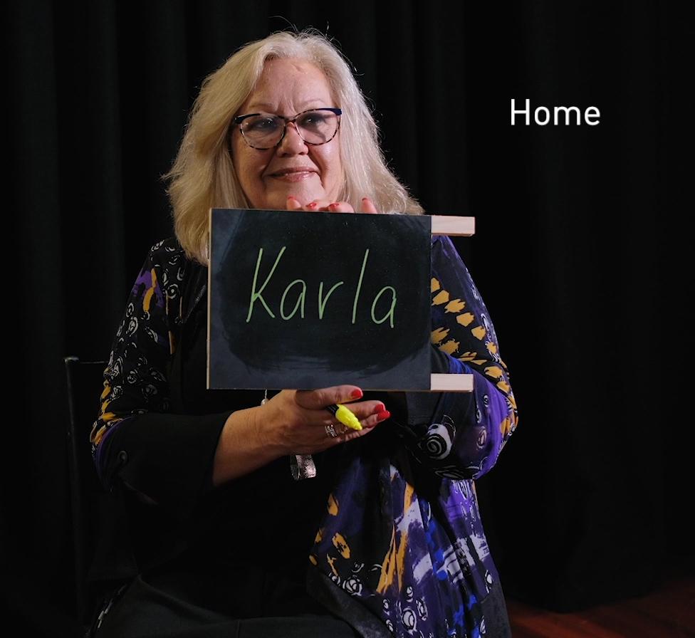 Woman holding chalkboard.