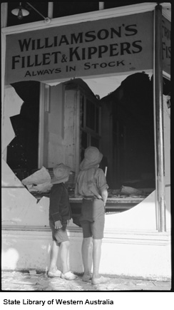Two boys at the broken window of a store after the Kalgoorlie Riots
