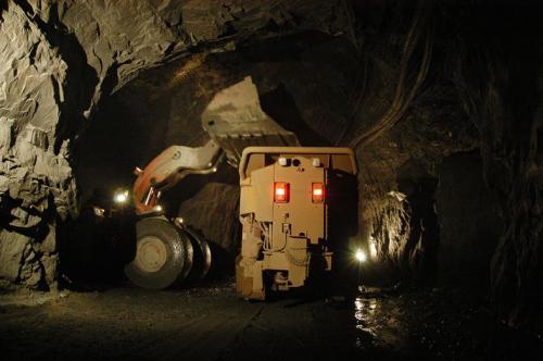 Dump truck working in a mine underground.