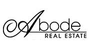 Abode Real Estate logo.
