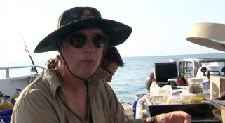 Lynda Avery on deck of the Kimberley Quest with sunglasses and hat on