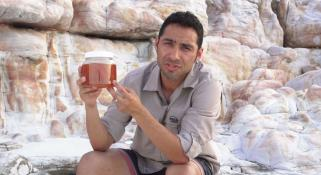 Oliver Gomez holding sponges collected from a reef