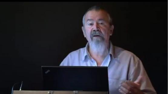 Profile of Mack McCarthy delivering a lecture