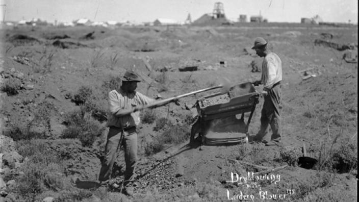 Two men prospecting with the Lordern Dry Blower, 1890s