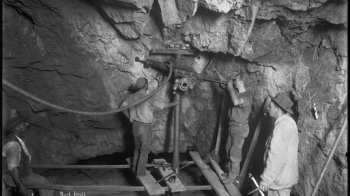 Miners using a pneumatic drill at the Golden Horseshoe Mine, c.1900