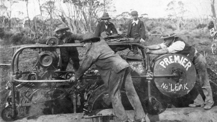 Men using an electric caulking machine, c1902
