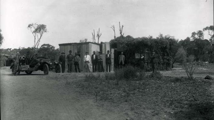 Men outside Mrs Irvine's Tearooms near Hampton Plains condenser, c.1920s