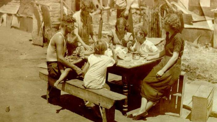 Rulyancic family sitting at a table after the Kalgoorlie riots, 1934