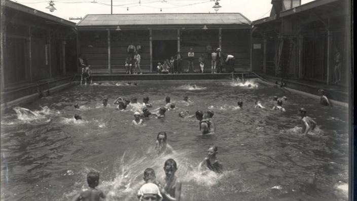 Taking a break from the heat in the Kalgoorlie Baths, 1917
