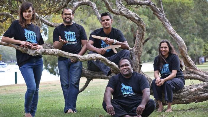 The Yirra Yakkin cast posing near a tree branch