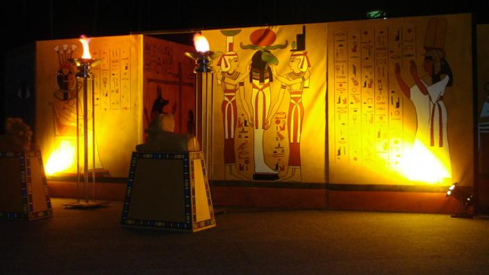 An ancient Egyptian themed wall with low lighting
