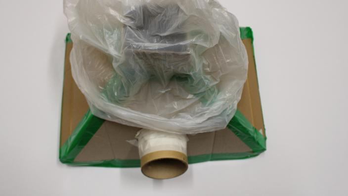 cardboard flue and bin bag