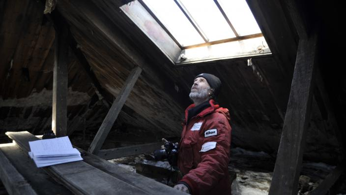 Dr Godfrey inspecting the hut in 2012