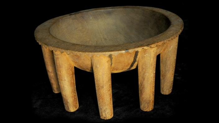 A wooden kava bowl with many legs