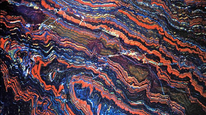 A striking colourful banded rock formation