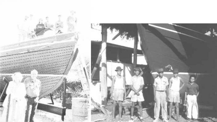 A large group of people next to the boat they built