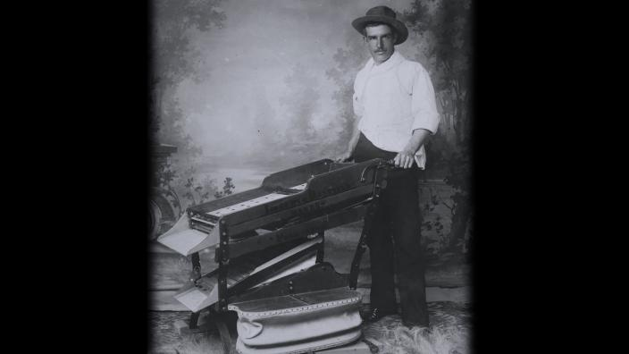A man operating a piece of mining equipment from the 19th century