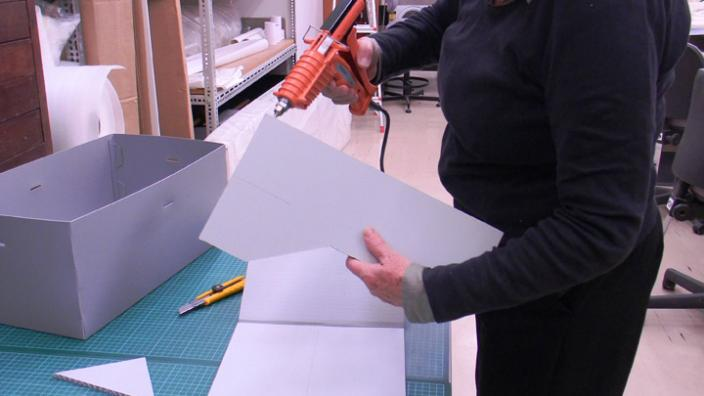 Performing textiles conservation work on a bonnet