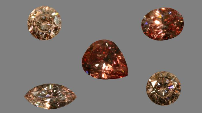A staged photo of a series of pink diamonds