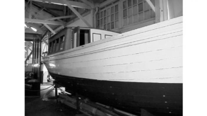 A large steam boat, moored onshore