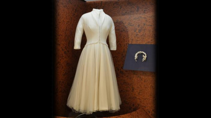 A wedding dress in a display cabient