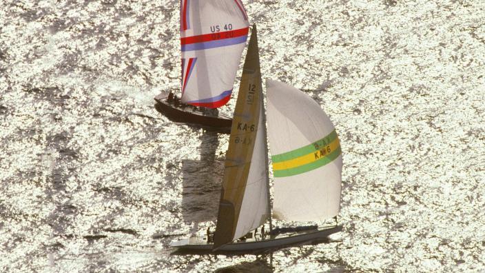Australia II and Liberty sailing around the America's Cup Buoy