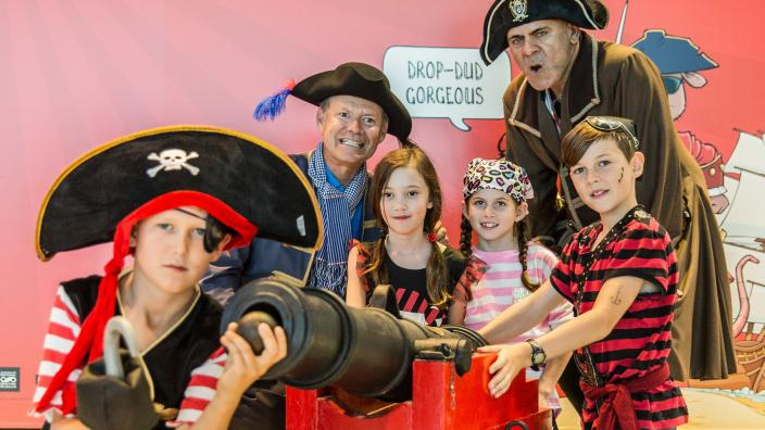 """""""A group of dastardly pirates, surrounding a pirate ship cannon."""""""