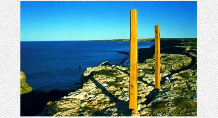 Two modern posts located near the coastline