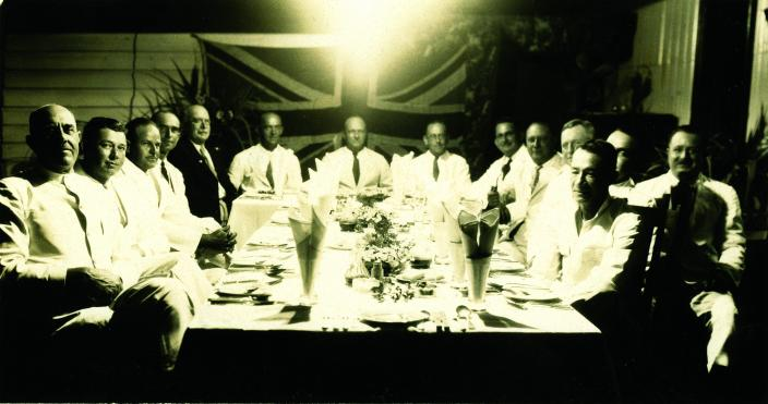 A group of men sitting around a table.