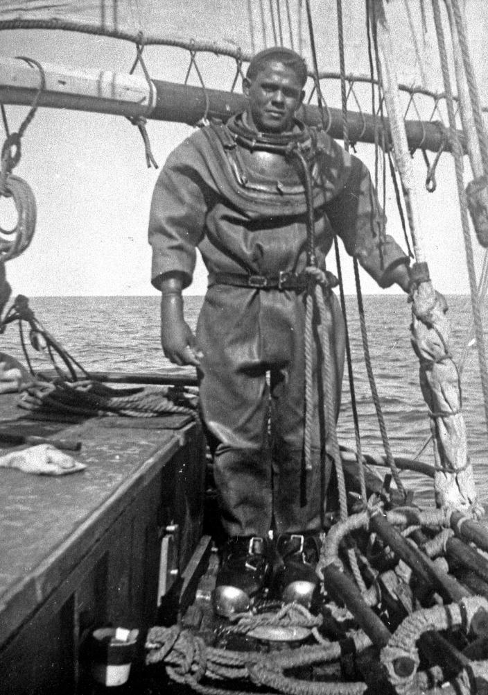 Image of a diver dressed in his gear